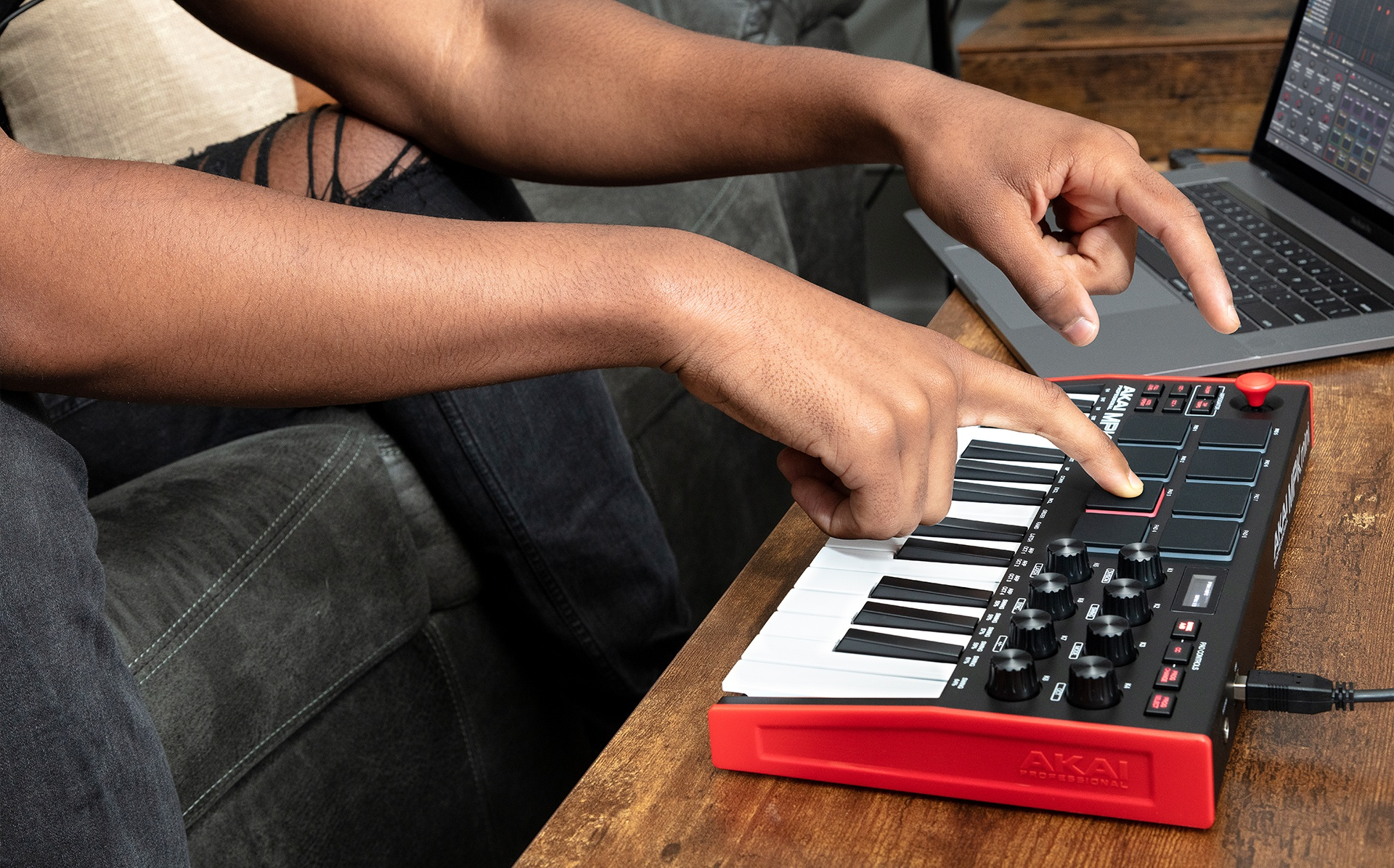 Music producer playing MPC pads on MPK Mini